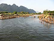 The Construction of River Bars at the Nam Song River at Vang Vieng by Asienreisender