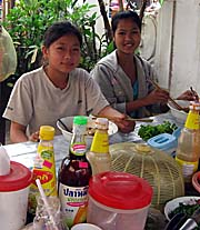 Laotian Girls having a Noodle Soup by Asienreisender