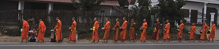 Monks in the morning streets of Luang Prabang by Asienreisender