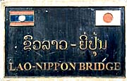Sign of the  Lao-Nippon Bridge in Pakse by Asienreisender