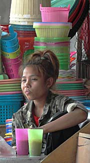 A teenager in Pakse by Asienreisender