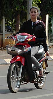 A Girl on a Motorbike in Pakse by Asienreisender