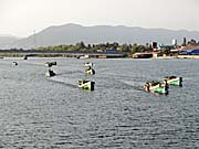 Fishing Boats on Kampot's Teuk Chhou River by Asienreisender
