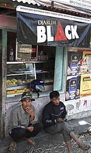 'Javanese Men, hanging out in front of a Street Restaurant' by Asienreisender