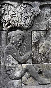 Man sitting under a tree | Borobodur Relief by Asienreisender