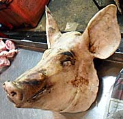 'A Pigshead for Sale on Ranong's Fresh Market' by Asienreisender