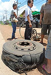 'Broken Tyre of a Bus' by Asienreisender