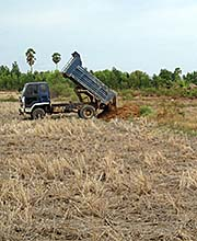 'Land Filling in a Rice Paddy in Cambodia' by Asienreisender