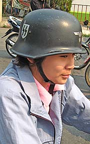 'Thai Woman with a Nazi Helmet in Chiang Rai' by Asienreisender