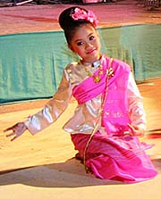 'Girl on a Theater Stage, Performing Thai Dance in Chiang Mai' by Asienreisender