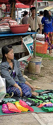 'A Tribal Girl selling Clothes on the Friday Market in Chiang Khong' by Asienreisender